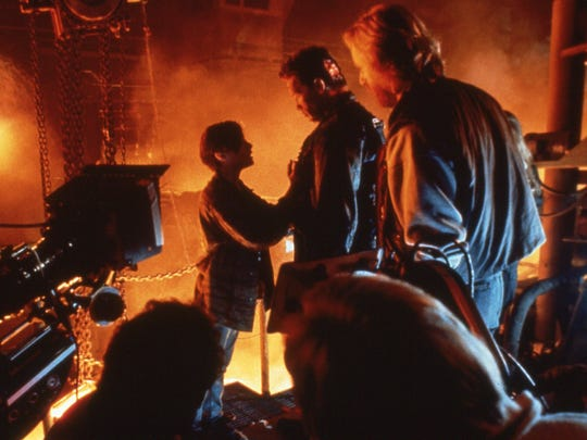 James Cameron (right) looks on as John Connor (Edward