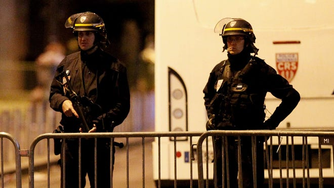 French police stand guard near the Stade de France.
