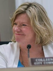 Commissioner Colleen Pobur reacts to her election as Plymouth's mayor pro tem.