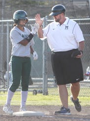El Diamante's Tahmia Beavers gets a high-five from