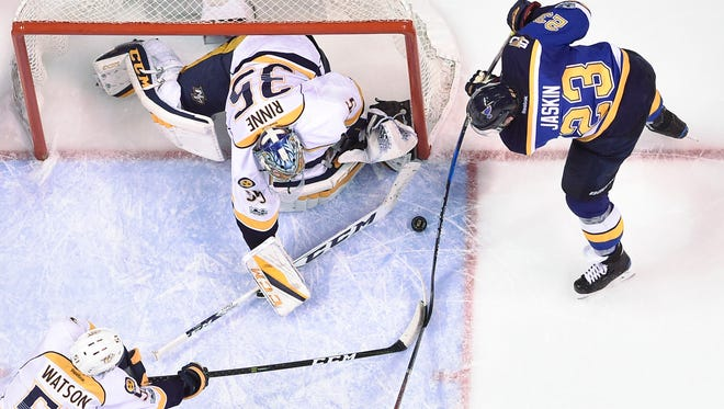 Nashville Predators goalie Pekka Rinne (35) blocks a shot by St. Louis Blues right wing Dmitrij Jaskin (23) during the third period in game 5 of the second round NHL Stanley Cup Playoffs at the Scottrade Center Friday, May 5, 2017, in St. Louis, Mo.