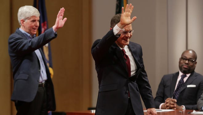 Republican Gov. Rick Snyder, left, and Democratic challenger Mark Schauer wave good-bye after a town hall in Detroit on Oct. 12.