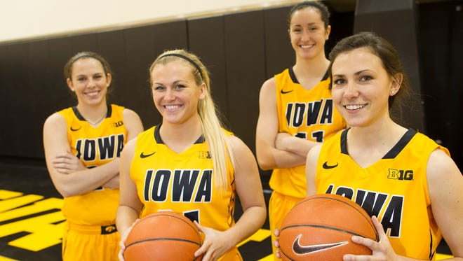 Iowa seniors Samantha Logic, from left, Melissa Dixon, Bethany Doolittle and Kathryn Reynolds pose for a photo during women's basketball media day at Carver-Hawkeye Arena on Thursday, Oct. 30, 2014.
