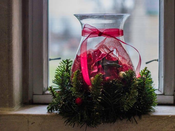 Christmas decorations sit in windowsills inside St.