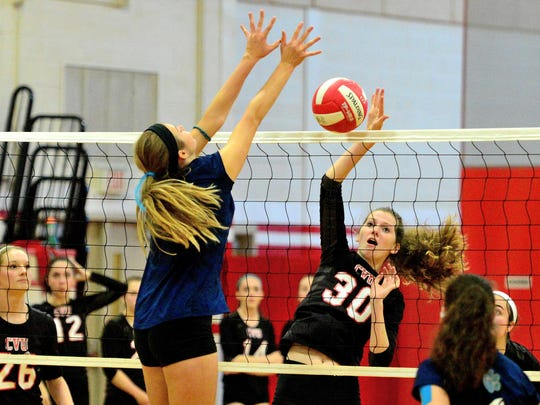 Natalie Senior gets the kill during the CVU girls semifinal volleyball match against Mount Mansfield earlier this week.