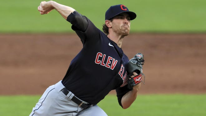 Cleveland Indians' Shane Bieber (57) throws during a baseball game against the Cincinnati Reds in Cincinnati, Tuesday, Aug. 4, 2020. The Indians won 4-2.
