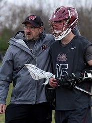 Wayne Hills coach Marc Jacobson with Jack Fieggen.