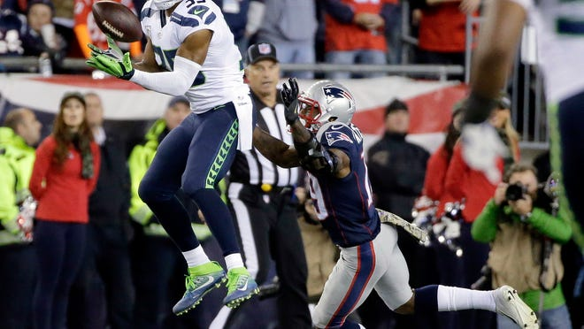 FILE - In this Nov. 13, 2016, file photo, Seattle Seahawks cornerback DeShawn Shead (35) intercepts a pass intended for New England Patriots wide receiver Malcolm Mitchell, right, during the first half of an NFL football game in Foxborough, Mass. While each of the eight NFL teams in playoff action this weekend has stars everyone has heard of, Tom Brady; Aaron Rodgers; Richard Sherman, there are also lesser-known players like Shead, who could play key roles in the divisional-round games. (AP Photo/Steven Senne, File)