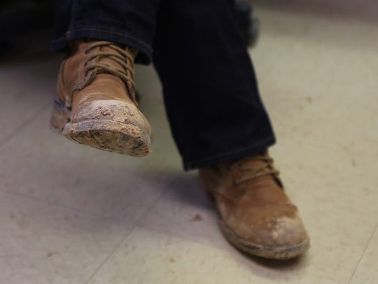 Sister Beverly Burgess wears work boots for her mission
