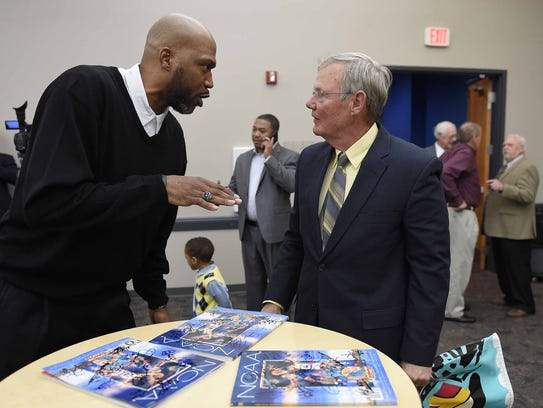 Dontae Jones (left) chats with Rick Cleveland, historian
