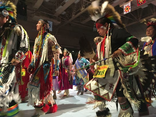 Dancers take part in the grand entry to the Gathering