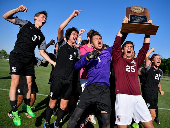 Station Camp goalkeepers Alex Sanchez (1) and Christopher Palevo (25) hold their trophy after their Class AAA championship victory against Houston last season.