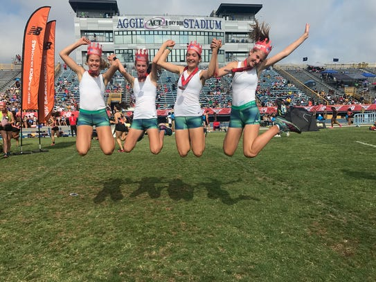 The Randolph 4xMile celebrates after earning All-America