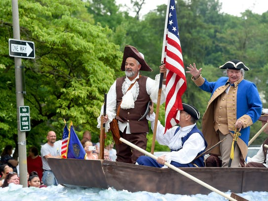 Members of American Legion Post 13 ride in the Fourth