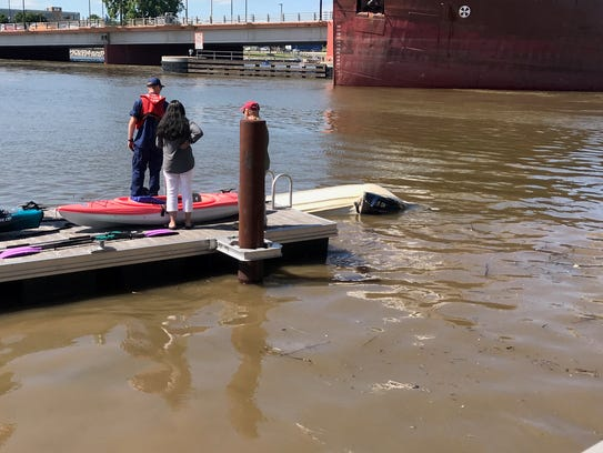 A boat was destroyed Sunday after being struck by a