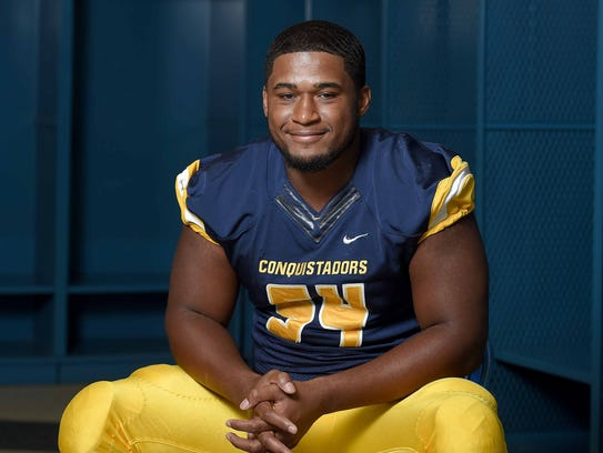 Olive Branch defensive end Fabien Lovett poses for pictures at the Dandy Dozen photo shoot at Mississippi Veterans Memorial Stadium in Jackson on July 26, 2017.