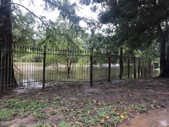 A park is closed due to flooding from Tropical Storm