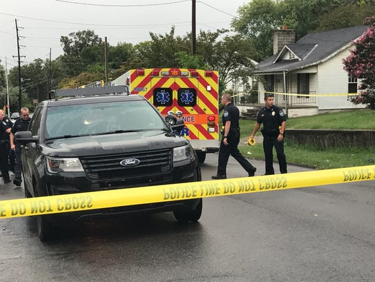 Police investigate the scene of a shooting in the Beaumont