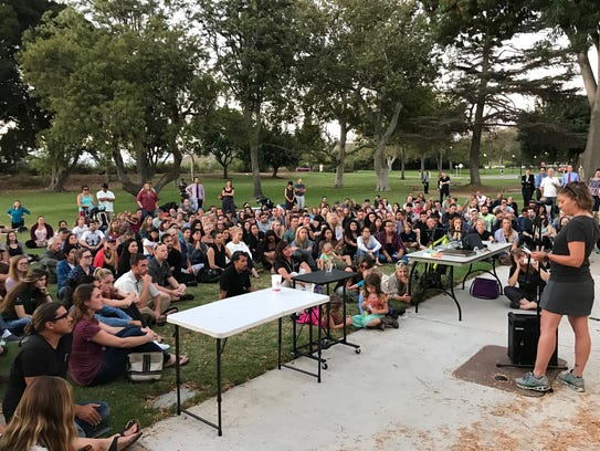 People gathered in a park at CSU Channel Islands Tuesday