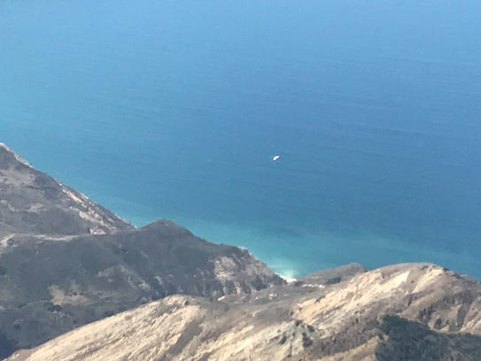 A smokejumper parachutes down to Santa Cruz Island