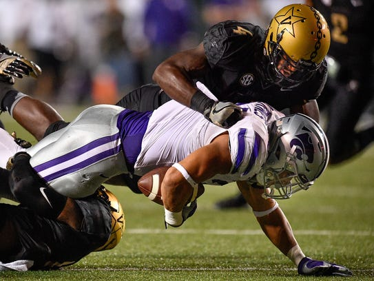 Kansas State running back Alex Barnes (34) is tackled