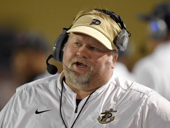 Pearl head coach John Perry talks on his headset on