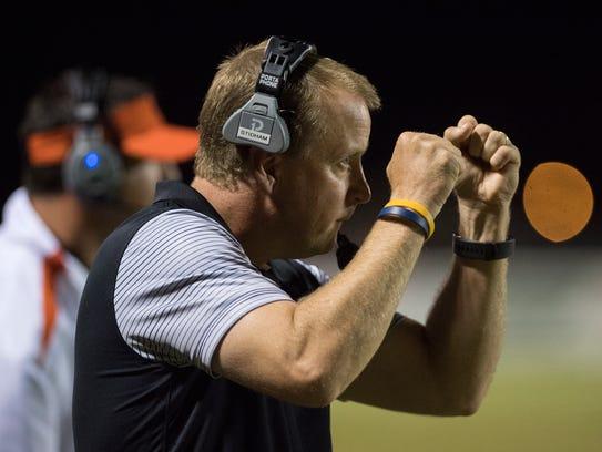 South Gibson Head Coach Scott Stidham signals to his