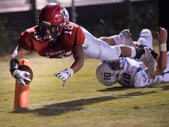 Lexington's De'Andre Scott dives into the end zone