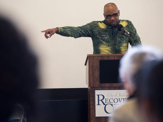 Recovery court graduate Brandon Love gestures to his
