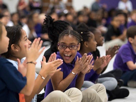 Fourth-grader Jai'Leah Willis applauds Miss Tennessee