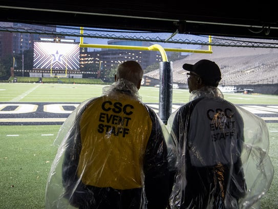 Security watch rain fall before a game between Vanderbilt