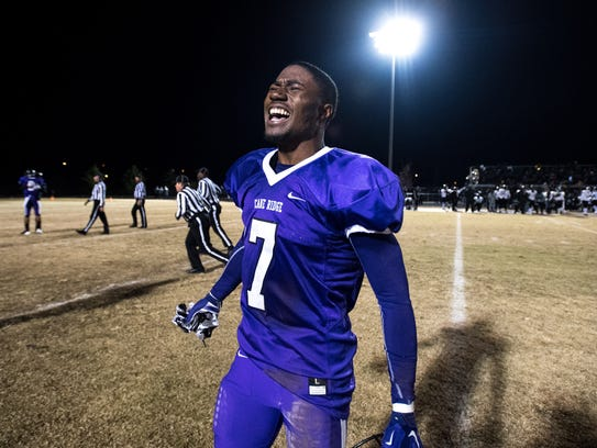 Cane Ridge's Jarad McCray (7) reacts after their Class