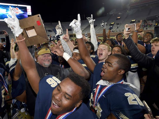 The Pearl Pirates and head coach John Perry celebrate