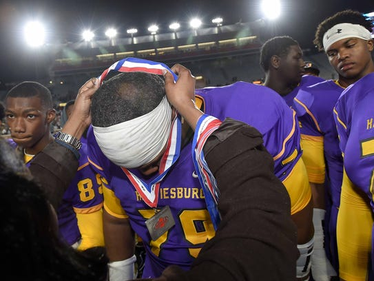 The Hattiesburg Tigers receive their silver medals