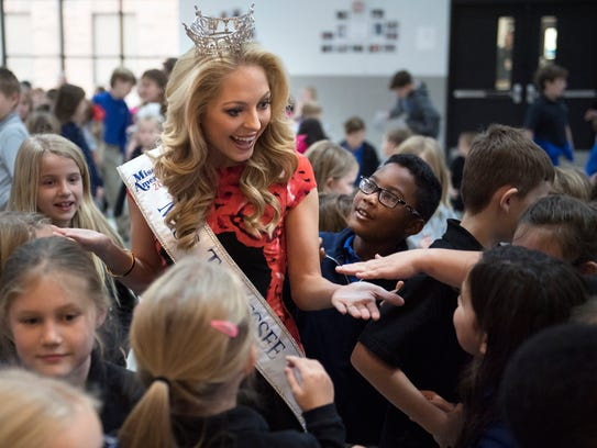 Miss Tennessee Caty Davis high-fives elementary students