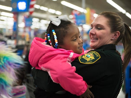 Madison County Deputy Whitney Watkins carries 3-year-old