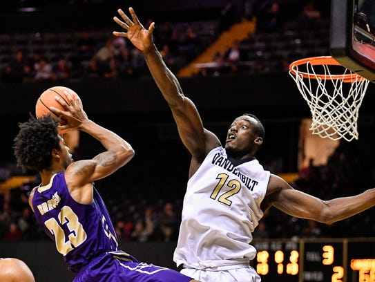 Vanderbilt center Djery Baptiste (12) guards Alcorn