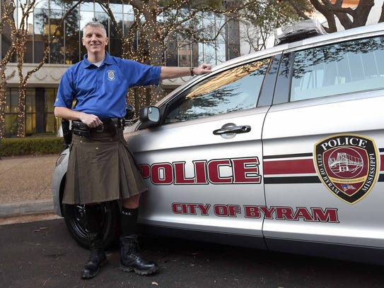 Byrum Police Chief Luke Thompson poses in his kilt