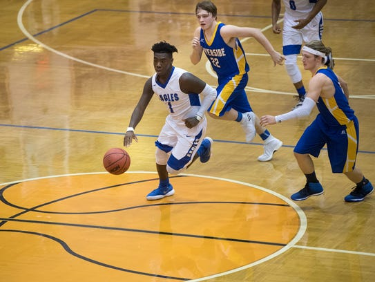 Chester County's Jusino Prather dribbles the ball down