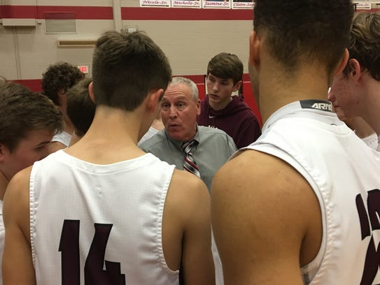 Bowie coach Doug Boxell talks to the Jackrabbits during