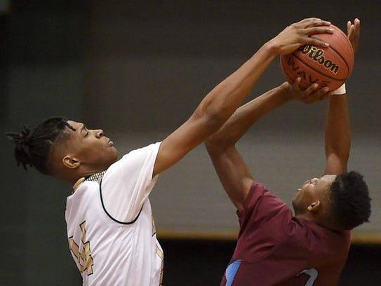 New Hope's Tyler Stevenson (14) blocks the shot by