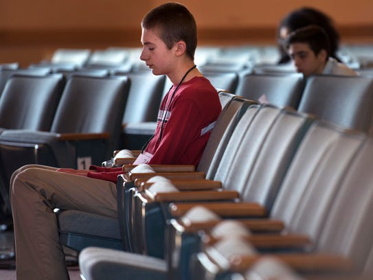 Augustine School student Noah Brandt takes a moment to himself between rounds during the West Tennessee Regional Spelling Bee on Saturday, March 3, 2018, at G. M. Savage Chapel at Union University. Brandt was awarded second place in the regional competition.