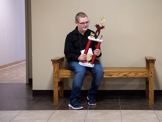 Lakewood Middle School student Connor Bevan admires