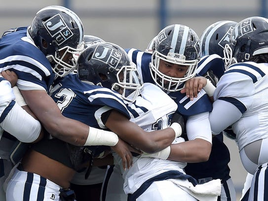Jackson State's Jordan Johnson (17) is stacked up as