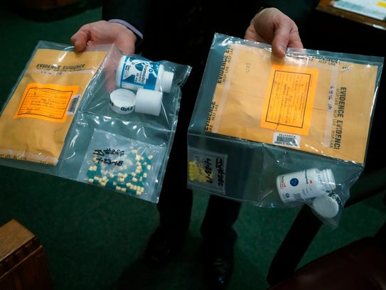 The prosecution shows prescription drugs that will