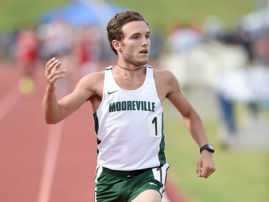Mooreville's Dylan Allen wins the Class 2A 1600 meters,