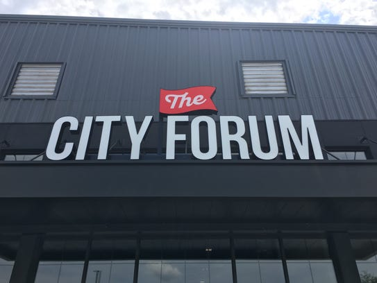 The giant entrance sign is up. Opening day is Tuesday,