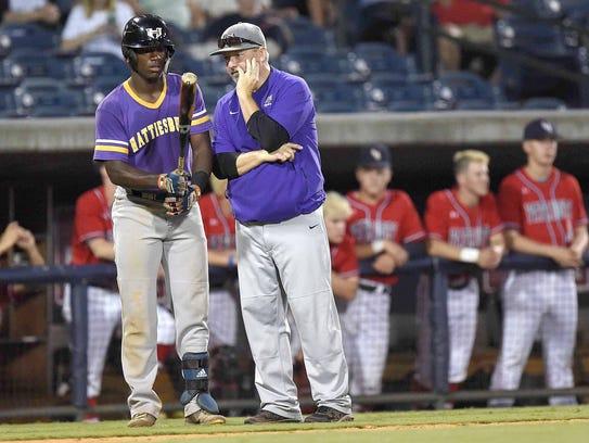 Hattiesburg head coach Joel Hartfield talks with Dexter