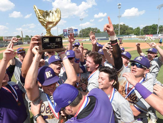 The DeSoto Central Jaguars celebrate with the Class