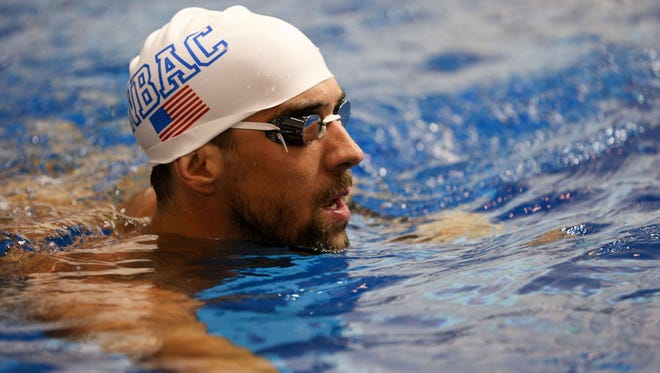 Michael Phelps warms prior to competitions in the Saturday finals of the Bulldog Grand Slam at Gabrielsen Natatorium.